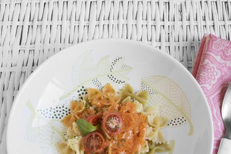 elaboration: casserole, Italian filled pasta with tomato, rustic background