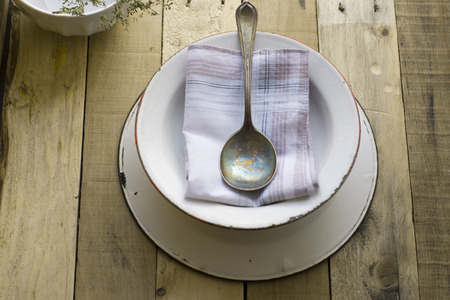 empty soup bowl with spoon on old wooden background photo