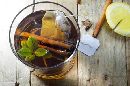white tea: healthy cup of hot tea on wooden background, lemon and cinnamon  Stock Photo