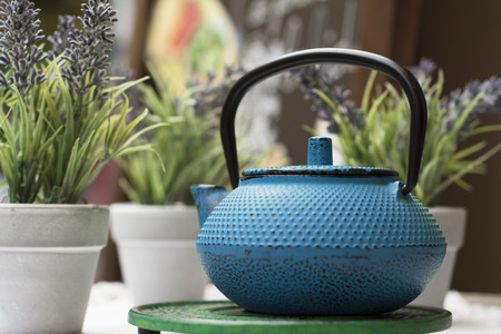 Chinese teapot in bright blue, Outdoor infusion Stock Photo
