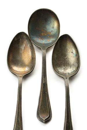 scuff: three old spoons on Isolated background, scuff marks Stock Photo