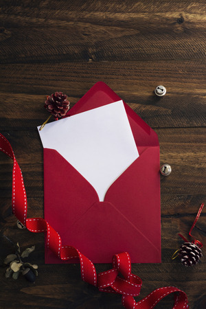 red envelope, white note and Christmas decoration photo