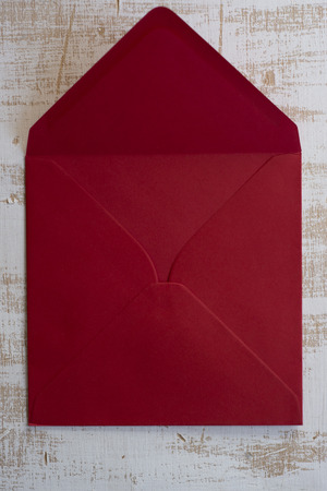 importantly: Open Red envelope, wood background