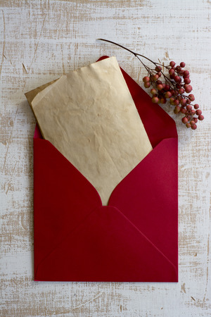 Red envelope, vintage letter, weathered white wood