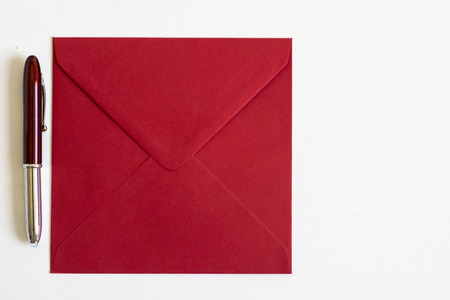 importantly: red Envelope and pen on isolated background