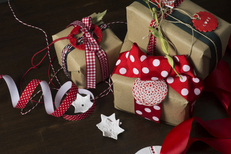 Christmas gifts, retro decoration, stars and red ribbons, wrapped in craft paper photo