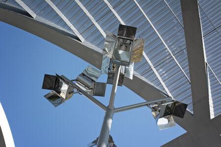prespective: modern street lamp on metal mesh, horizontal image Stock Photo