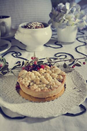 cherry pie: Delicious homemade cherry pie on floral tablecloth Stock Photo