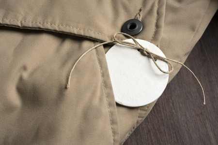Price Tag, in the pocket of a jacket beige winter photo