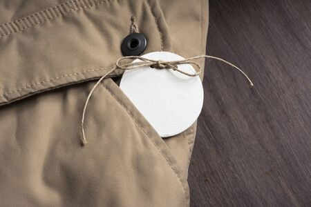 Price Tag, in the pocket of a jacket beige winter