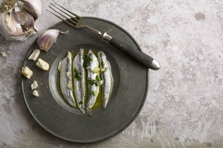 noun: anchovies in vinegar with garlic and olive oil