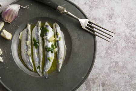 anchovies in vinegar with garlic and olive oil