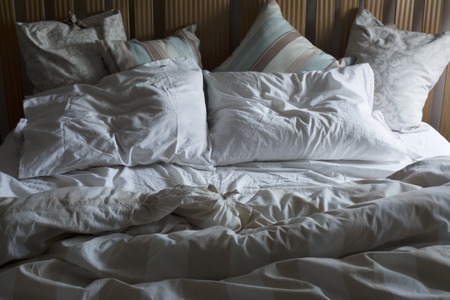 unmade: Double bed unmade, with the morning light Stock Photo