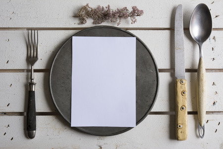 Rustic place setting menu on old white wooden Stock Photo