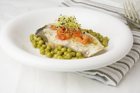 hake: Hake fillet with tomato and sprouts,