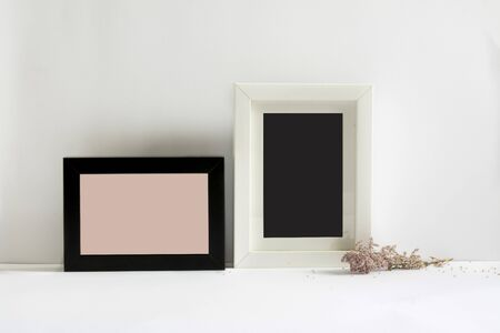 papeles oficina: empty picture frames, decorated with pink flowers, white background