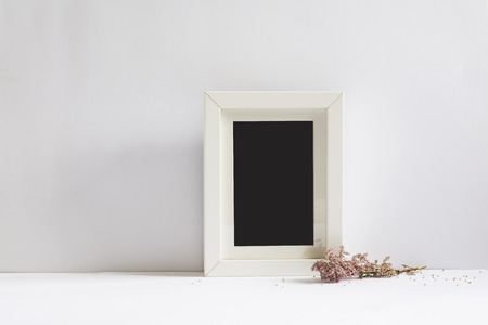 pink wall paper: empty picture frame, decorated with pink flowers, white background