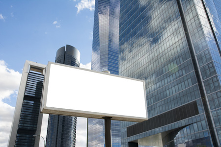 advertising text: Blank billboard in front of office skyscraper