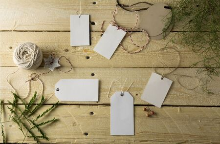 price label: Set of empty paper price tags, wooden background