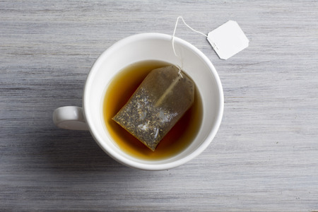 healthy cup of hot tea with bag Stock Photo