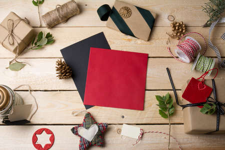 empty greeting cards and Christmas ornaments on wooden background Stock Photo