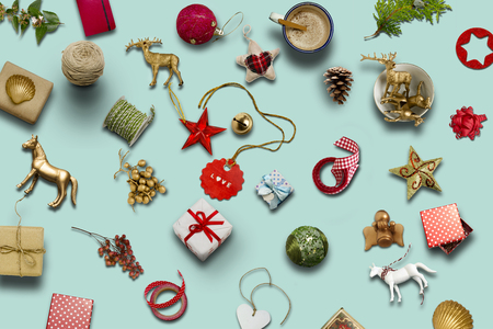 Christmas collection, gifts and decorative ornaments, on blue background. photographic montage Archivio Fotografico