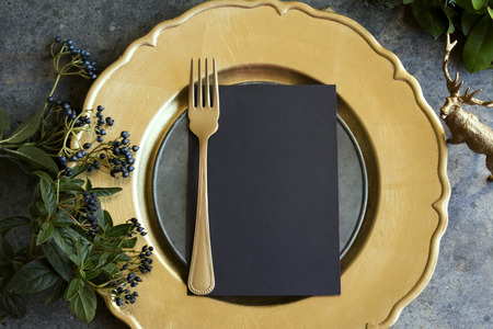 old new: Gold place setting with empty menu on grunge Stock Photo