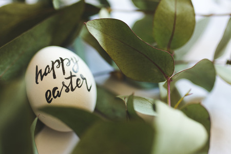 eastertime: Happy easter stamp on the eggs, drawn with pen from above. Stock Photo