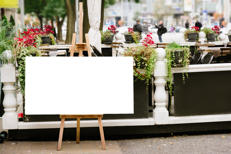 Blank Board menu, stand mock up, on the terrace of the restaurant, outdoors on the sidewalk. Stock Photo
