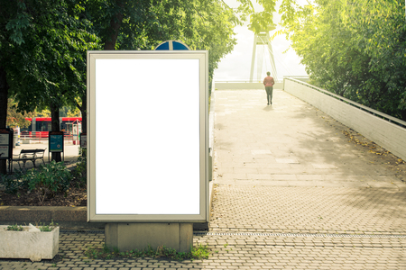 Blank mock up, of vertical street poster billboard on city background, daytime