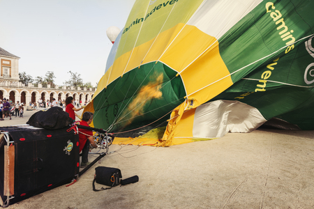 ARANJUEZ, SPAIN - OCTOBER 14, 2017, Man inflating aerostatic balloon. balloon festival Aranjuez, Spain, Organized by the ballon company.
