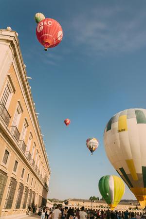 ARANJUEZ, SPAIN - OCTOBER 14, 2017,  hot ballon air flying next to the palace of Aranjuez, Spain. balloon festival Aranjuez, Spain, Organized by the ballon company. Editorial