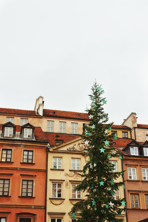Christmas tree decoration in Warsaw Old Town Market Square, detail of the old colorful facades Stock Photo