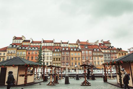 WARSAW, POLAND - NOVEMBER 27, 2017: Christmas market in Warsaw Old Town Market Square, detail of the old colorful facades Editorial