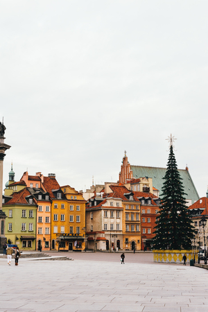 WARSAW, POLAND - NOVEMBER 28, 2017: Christmas tree in Castle Square. Plac Zamkowy (Stare Miasto), in the center, the column of Sigismund III, and Royal Castle, Krakowskie Przedmie?? Cie street. A UNESCO world heritage site. Warsaw Old town. In Christmas