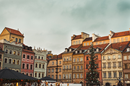 Christmas decoration in Warsaw Old Town Market Square, detail of the old colorful facades Stock Photo