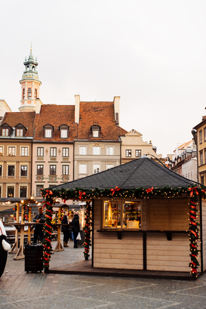 Christmas market in Warsaw Old Town Market Square, detail of the old colorful facades
