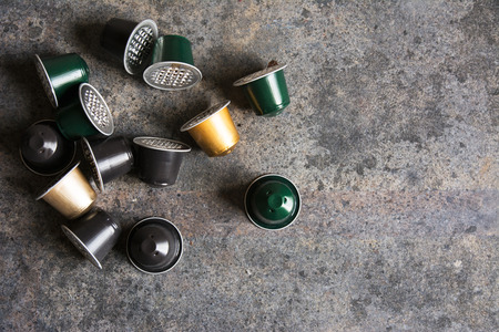 Coffee capsules, for electric coffee makers. on grunge background Stok Fotoğraf - 110313860