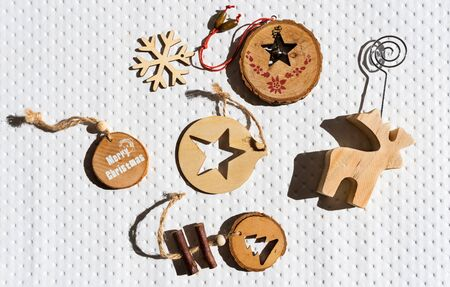Modern wooden ornaments with a Christmas message for decoration. Christmas background