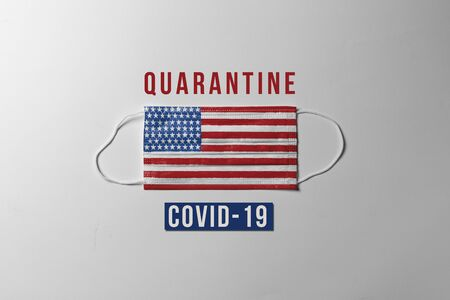 Covid-19. Surgical mask with the United States flag showing the message