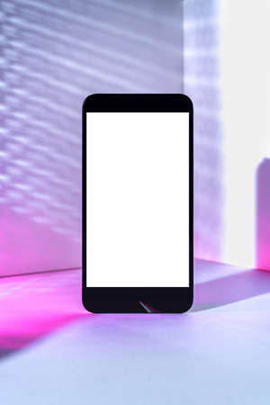 Minimalist modern smartphone mockup for presentation, in perspective in front of the corner angle of the wall, with overlapping shadows and gradient holographic colors. application display, information or graphics