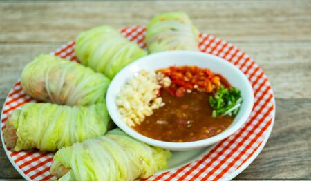 carne picada: Stuffed cabbage roll on wood background Foto de archivo