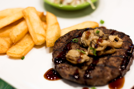 beefsteaks: grills beef steak on playe with blur background