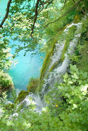 murmur: Water falling into the turquoise lake.