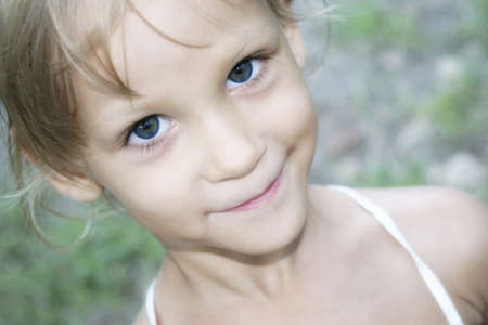 only girls: Little girl looks upward and smiles modestly