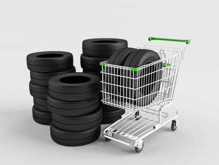New tires in a shopping trolley on a white background  Stock Photo