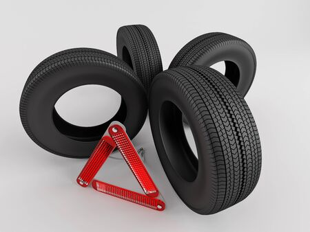 Four tires and warning triangle Stock Photo