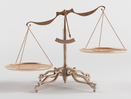 kilograms: Old brass scales are tilted in one direction