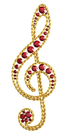Golden decoration with ruby ​​as the treble clef Stock Photo