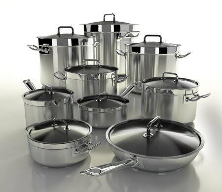 A set of stainless steel pans on a light backgroun